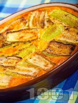 Бърза и вкусна запеканка от тиквички с ориз и заливка от яйца, брашно и прясно мляко - снимка на рецептата